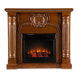 SEI - Romano Electric Fireplace - Salem Antique - Hand-carved columns and a center medallion pair with a Salem antique oak finish in this electric fireplace that exudes character and style. To top it off, this fireplace requires no electrician or contractor for installation, allowing for instant remodeling without the usual mess or expenses. This Victorian-esque fireplace features striking hand-carved elements, including classic columns and a large crest. The splendid details of the design make this fireplace a timeless addition to your home. The electric insert features realistic flickering flames and glowing embers - brightness of each can be adjusted with a simple push of a button. In addition to adjusting the thermostat, the electric fireplace also offers the option of using with or without heat for year-round enjoyment. Convenience and ease of assembly are just two of the reasons why this fireplace is perfect for your home. The ornate, elegant style of this fireplace works well in traditional and transitional homes. This handsome fireplace is great for the living room and bedroom, and even adds a warm, romantic touch to the dining room or home office. Let this portable fireplace give your home a more welcoming and enjoyable atmosphere.