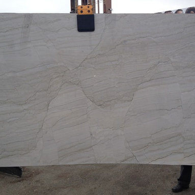 White Macauba Quartz Granite Slab from Royal Stone & Tile - White Macauba Quartz Granite Slab from Royal Stone & Tile is a great option for people looking for that white marble kitchen countertop look without all the special care that marble requires.  One of out best selling granite slab materials.