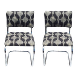 Pre-owned 1970's Chrome Chairs - A Pair - This pair of 1970's chrome bent chairs are perfect for the vintage enthusiast! The fun textile mixed with the simple, chic design makes for the perfect retro-modern combination. Not only do they look great in any room, but they are comfortable too!