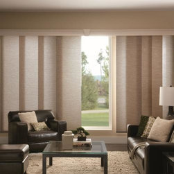 Bali Fabric Sliding Panels - Choose Bali Fabric Sliding Panels from Blinds.com to bring a sleek and modern look to your patio doors or larger windows. Also known as Panel Track, this product can also be used to cover a closet or as a room divider. With over 100 fabrics in an array of colors, patterns or textures, including solar screen, light filtering and room darkening opacities, you're sure find the perfect complement to your decor. These panels will glide gracefully across a durable aluminum track.