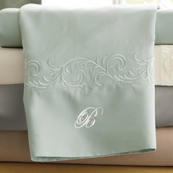 """Frontgate - Set of Two Resort Pillowcases - MicroCotton is a patented finishing process for superfine long-staple cotton that results in an ultra-soft hand and drape. Sateen weave feels lightweight and luxurious on the skin. Retain their luster and softness wash after wash. Elegant tailored or embroidered hem options. Set includes a flat sheet, fitted sheet and two pillowcases. Beautiful, breathable and amazingly soft, our exclusive Resort Sheets are inspired by linens on the finest hotel beds. Breathable long-staple cotton fibers are finished using the proprietary MicroCotton process and sateen woven to an elegant 600 thread count. The result is a smooth feel, glossy sheen and excellent drape. The only thing missing is the turndown service.. . . . . The fitted sheet has a 16"""" deep pocket to fit luxury mattresses. Optional 2"""" monogram available. Machine wash."""