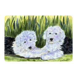 Caroline's Treasures - Old English Sheepdog Kitchen or Bath Mat 24 x 36 - Kitchen or Bath Comfort Floor Mat This mat is 24 inch by 36 inch. Comfort Mat / Carpet / Rug that is Made and Printed in the USA. A foam cushion is attached to the bottom of the mat for comfort when standing. The mat has been permanently dyed for moderate traffic. Durable and fade resistant. The back of the mat is rubber backed to keep the mat from slipping on a smooth floor. Use pressure and water from garden hose or power washer to clean the mat. Vacuuming only with the hard wood floor setting, as to not pull up the knap of the felt. Avoid soap or cleaner that produces suds when cleaning. It will be difficult to get the suds out of the mat.