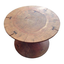 Pre-owned Solid Acacia Wood Round Coffee Table - A round solid acacia wood coffee table with butterfly joinery. This table has a stylish organic presence that will add texture and depth to your room.