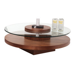 Beverly Hills Furniture Inc. - Revere Round Coffee Table with Rotating Top in Walnut Finish - The Revere Round Coffee Table with Rotating Top in Walnut Finish - Beverly Hills Furniture Inc. is rotating top coffee table with 12mm glass top and thick bottom shelf. Modern round rotatable coffee table is absolutely unique piece for top-quality modern living room.