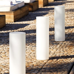 Smart & Green - XS Tower LED Outdoor/Indoor Lamp - The Tower is a waterproof, wireless, rechargeable and energy efficient lantern that can be used indoors or outdoors. Perfect for brightening up backyard barbecues and setting a romantic atmosphere poolside; it is designed to thrive in bad weather and has a guaranteed high resistance to shocks. Is also portable and easy to move indoors. Features red, blue and green the pre-defined colors. Dynamic mode with unlimited colors changing automatically. Also features yellow flickering candle effect. Up to 20 hours or power in one charge. Optional remote control sold separately. Includes 52 LED lamps totaling 10 watts. General light distribution. 9 inch diameter x 25 inch height. IP68 rated for wet locations.