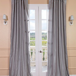 Silver Vintage Textured Faux Dupioni Silk Curtain - Our Vintage Textured Faux Silk curtains & drapes have a slight sheen that mimics the finest texture of silk dupioni. These curtains bring the look of luxury without the cost or high-maintenance care. Built-in are two header designs within a single panel. The attached back tabs for a formal pleated look and a traditional pole pocket.