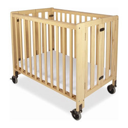 Foundations - Folding Compact Crib w Mattress - HideAway - The crib was manufactured in 2011 or later and complies with the new federal safety standards issued by the CPSC. Made of Hardwood. Includes 2 in. Foam Professional Series mattress which provides superior comfort and is Antimicrobial. 4 in. non-marking, ultra-quiet casters that will maneuver any surface to meet the demands of constant use. Constructed from solid Wood and has a full 1 year warranty. Some assembly required. Sleeping Surface: 24 in. W X 38 in. L. Overall Dimensions: 36.25 in. W x 39.6 in. L x 26 in. H (46 lbs.). Crib Safety: ivgStores cares about the safety of the products we sell especially for your new little one. We work closely with our manufacturers and only carry those items which meet or exceed federal and state laws. If you are considering buying a new crib or even using a previously owned or heirloom crib, we recommend you visit  cribsafety.org to learn more about crib safety.The HideAway crib blends safety, convenience and functionality at an affordable price. Through the door sizing fits through standard doorways in fully assembled position for ease of movement. JPMA certified. Foundations uses only Wood certified to having been harvested with safe and responsible forestry practices and all products comply with the PEFC certification seal.