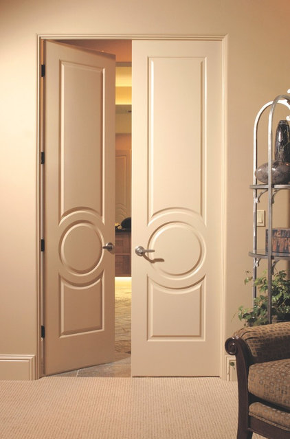 Traditional entry by interior door and closet company for House room door design