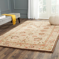 Safavieh - Safavieh Handmade Anatolia Ivory/ Beige Hand-spun Wool Rug - Create a beautiful focal point in any room when you add this handmade wool area rug. Featuring a classic,delicate design in tones of red,ivory,and brown with a beige background,this rug adds timeless sophistication to your existing decor.