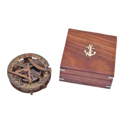 Handcrafted Nautical Decor - Antique Brass Round Sundial Compass w/ Rosewood Box 6'' - This is a beautiful Hampton Nautical 6-inch Antique Brass Round Sundial Compass with Rosewood Box. The top of the sundial is hinged and a curved scale is used to set your local latitude angle. The magnetic compass allows the sundial to be oriented North. The compass features a needle lift mechanism to protect the compass' jeweled bearing when being transported. There are three adjustable legs that are used to precisely level the sundial. The sun's shadow cast by the sundial's vane marks the local time.--The top of the sundial can lay down flat, and both the latitude scale and the sundial vane are hinged to lay flat for compact storage. A beautiful hardwood case is included for display and storage of the antique brass sundial.  The box has an anchor with rope Hampton Nautical embedded in the top of the box.--Custom Engraving is available on this item with a minimum quantity purchased. Contact us for details.-- ----    Antique brass housing for compass--    Needle lift operates to protect bearing--    Adjustable legs for precise sundial alignment--    Solid rosewood box lined with felt to store      compass--    Brass anchor emblem inset in face of rosewood box--    Custom engraving/ photo etching available; logos, pictures, and slogans can easily be put on any item. Typical custom order minimum is 100+ pieces. Minimum lead time for to produce and engrave is 4+ weeks. ----