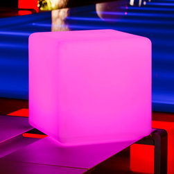 "Smart and Green - Cube - Outdoor Portable LED Lamp | Smart & Green - Smart & Green Lighting Cube Outdoor Portable LED Lamp features 160,000 light colors to choose from. For sitting down, as a coffee table or for stacking, Cube is designed for building your lighting scheme. White light, candle effect or 160,000 colors to choose from… there are so many options for your evening. Designed to stand up to bad weather, Cube may be used indoors or outdoors. This lamp is recharged by simply placing it on its base or by removing the bulb and placing it on the charging station. You therefore retain your harmonious atmosphere while the bulb recharges and provides you with light. And if you'd like to change the color or switch it off without getting up from your sofa, use Pebble, the compatible radiofrequency remote control unit that you'll find in the accessories section.""Cube"" is also right at home indoors or outdoors with its LED wireless module. The unique design of ""Cube"" is splashproof and garantee a high resistance to shocks. With 4 modes and 3 light intensities, ""Cube"" adapts to your environment to create the atmosphere that suits you. Low energy consumption through the use of LEDs. Manufacturer:�Smart & GreenSize:�14 in. square x 14 in. height Light Source:�RGB LEDs - included AC input:�Charger - included Battery Life:� 8 - 20 hours Location: WetRemote Control: Pebble or Kameleon - optional"