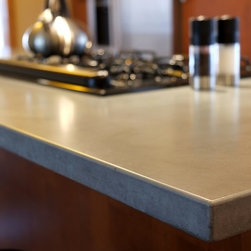 Concrete Counter Tops - This concrete counter top provides a organic feel with clean lines