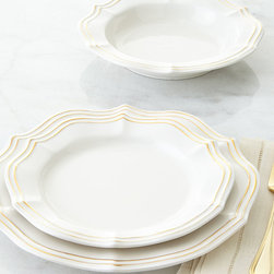 Holiday Entertaining - Pretty scallops with golden accents make this dinnerware a charming addition to any table setting.