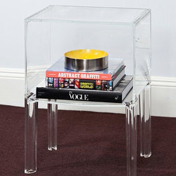 Nightstands and Bedside Tables: Kartell Small Ghostbuster Table - The Kartell small Ghostbuster table specified by Melanie Morris Design.  Designed by Phillippe Starck and Eugeni Quitllet, the Ghost Buster is the next generation of iconic ghost designs. This small table will look at home in any corner of the house, next to the bed, sofa or even in the bathroom. Available in completely transparent, colored or matte versions it is made of plastic and will complement any interior.  Nice when used as a bedside table, nightstand, living room side table or as a small bathroom organizer for towels and such.  Available from: http://www.stardust.com/smallghostbuster.html