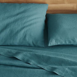 Lino Teal Linen King Flat Sheet - Super soft, washed bedding in solid, gorgeous hues spreads the bed in the comforting touch and relaxed, worn-in style of pure linen.