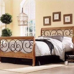 Dunhill Sleigh Bed - Wrought iron scrolls nestle into a wooden frame of the Dunhill Sleigh Bed. This handsome headboard has a classic sleigh shape made of wrought iron with an autumn brown finish set into durable wood with a honey oak finish. Matching footboard, rails, and frame sold separately.About Fashion Bed GroupFashion Bed Group is a Leggett and Platt Company known for its innovative fashion beds, daybeds, futons, bunk beds, bed frames, and bedding support. Created in 1991, Fashion Bed Group is a large consolidation of three leading bed manufacturers. Its beds are manufactured of genuine brass, plated brass, cast zinc, cast aluminum, steel, iron, wood, wicker, and rattan. Fashion Bed Group's products are distributed throughout North America from warehouses located in Chicago, Los Angeles, Houston, Toronto, and Ennis, Texas.