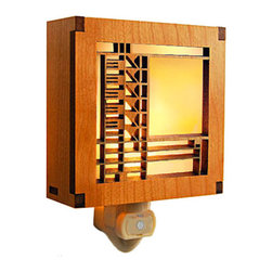 "Lightwave Laser - Frank Lloyd Wright Bach House-inspired Night Light - The design source for this Frank Lloyd Wright Night Light is adapted from an art glass window originally found in the Emil Bach House (Chicago, IL, 1915). This stunning Frank Lloyd Wright Emil Bach House design hardwood night light is precision laser cut for quality of finish and design accuracy. The night light has a built in light sensor to automatically turn on and off. Complete with a 7 watt night light bulb. Ht: 4"". W: 4"". D: 1.5""."
