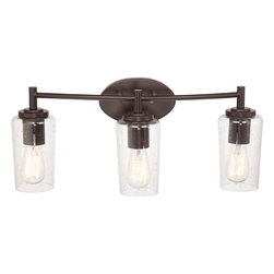 Quoizel - Edison Western Bronze Three Light Bath Fixture - - Bulb Included  - Cord Length: 6 Inches  - Glass/Shade: Seedy Glass Shade Quoizel - EDS8603WT