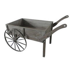None - Distressed Wood Cart with Wagon Wheels - This wood comes with a unique distressed wood look,adding a vintage,olde-time feel. This piece is sure to add some Western flair to any home or garden.