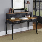 HomeStyles - Oak and Rubbed Black Executive Desk and Hutch - The Executive Desk is constructed of poplar solids, engineered wood and oak veneers in a distressed oak and heavily rubbed black finish. The distressed oak features several distressing techniques such as worm holes, fly specking, and small indentations. Features include six storage drawers (one being a drop down keyboard tray), and cable access through hutch. Design features include shaped carved proud legs, corner peg accents, and detailed brass hardware. Assembly required. 54 in. W x 28 in. D x 40 in. H