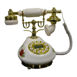 ORE International - Classic Telephone in Gold & White Finish - Indicator light, redial, pulse tone and tune switch. Anti-theft alarm. Display date and time . Embossed Red floral motif design. Displays incoming and outgoing calls. Gold accent base. 30 Days warranty. 9.5 in. L x 6 in. W x 8.25 in. H (4 lbs.)Escape from modern times with this European 1920's style telephone. The artistic design is a conversation piece in more ways than one. Traditional features that mesh old fashion with modern times.