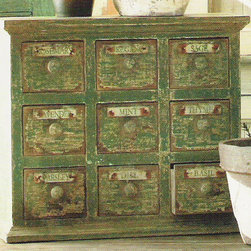 """Herbal Apothecary Cabinet - You'll find lots of storage for your favorite herbs in this hand-made aged reproduction herbal apothecary cabinet. Each of the nine drawers is labeled with the name of an herb. Measures 18""""W x 7""""D x 21.5""""H."""