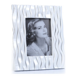 "Concepts Life - Concepts Life Photo Frame  Flowing Forward 5x7"" - Make your photos stand out with our white textured frame from the Flowing Forward collection. The beautifully woven pattern on this white frame is both elegant and eye-catching. Makes a memorable gift for any occasion.  Modern home accent Contemporary white picture frame Beautiful and elegant home accent Rectangular photo frame Made of polyresin Textured finish Easel back for horizontal or vertical display Various sizes available Holds 5 x 7 in. size photo Dimensions: 9""w x 10""h x 1""d Weight: 3 lbs"