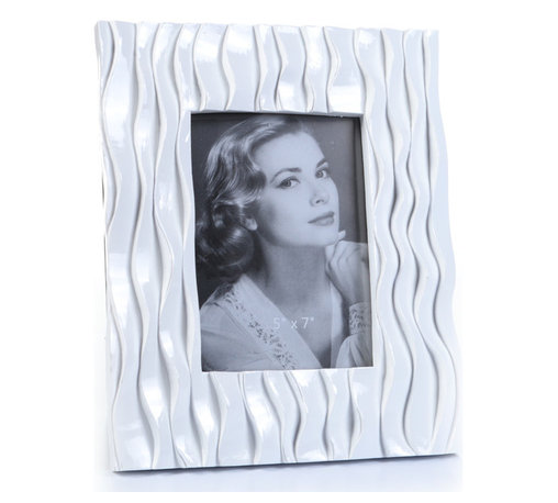 """Concepts Life - Concepts Life Photo Frame  Flowing Forward 5x7"""" - Make your photos stand out with our white textured frame from the Flowing Forward collection. The beautifully woven pattern on this white frame is both elegant and eye-catching. Makes a memorable gift for any occasion.  Modern home accent Contemporary white picture frame Beautiful and elegant home accent Rectangular photo frame Made of polyresin Textured finish Easel back for horizontal or vertical display Various sizes available Holds 5 x 7 in. size photo Dimensions: 9""""w x 10""""h x 1""""d Weight: 3 lbs"""