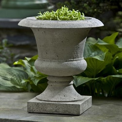 Campania International Toulouse Cast Stone Urn Planter - About Campania InternationalEstablished in 1984, Campania International's reputation has been built on quality original products and service. Originally selling terra cotta planters, Campania soon began to research and develop the design and manufacture of cast stone garden planters and ornaments. Campania is also an importer and wholesaler of garden products, including polyethylene, terra cotta, glazed pottery, cast iron, and fiberglass planters as well as classic garden structures, fountains, and cast resin statuary.Campania Cast Stone: The ProcessThe creation of Campania's cast stone pieces begins and ends by hand. From the creation of an original design, making of a mold, pouring the cast stone, application of the patina to the final packing of an order, the process is both technical and artistic. As many as 30 pairs of hands are involved in the creation of each Campania piece in a labor intensive 15 step process.The process begins either with the creation of an original copyrighted design by Campania's artisans or an antique original. Antique originals will often require some restoration work, which is also done in-house by expert craftsmen. Campania's mold making department will then begin a multi-step process to create a production mold which will properly replicate the detail and texture of the original piece. Depending on its size and complexity, a mold can take as long as three months to complete. Campania creates in excess of 700 molds per year.After a mold is completed, it is moved to the production area where a team individually hand pours the liquid cast stone mixture into the mold and employs special techniques to remove air bubbles. Campania carefully monitors the PSI of every piece. PSI (pounds per square inch) measures the strength of every piece to ensure durability. The PSI of Campania pieces is currently engineered at approximately 7500 for optimum strength. Each piece is air-dried and the