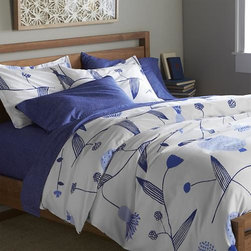 Marimekko Lompolo Twin Duvet Cover - Fujiwo Ishimoto's interpretation of the stark beauty of Finland's Lapland scatters line drawings of blue vines, leaves and flowers on crisp white cotton percale. Duvet has hidden button closure and interior fabric ties to keep insert in place. Duvet insert also available.