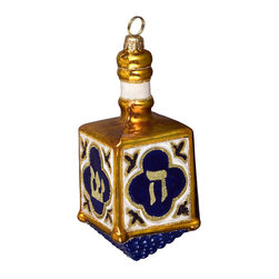 Frontgate - Dreidel Ornament - Hand-crafted heirloom ornament. Artfully painted blue and gold glass with gold glitter accents. Hebrew symbols adorn each side. Makes a wonderful gift to be treasured for years. This collectible Dreidel Ornament was designed with the utmost attention to quality and detail. Individually mouth-blown and handpainted, this ornament will make a shimmering addition to your Hanukkah decor. . . . . Made in Poland.