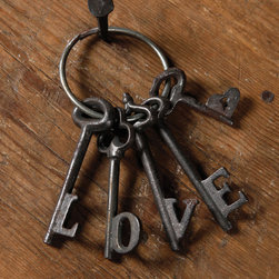 "Love Keys, Cast Iron - Natural - Subtly whimsical to blend interest with transitional formality, the Cast Iron Love Keys make an ideal door hanger or a point of interest�to ease the rigid geometry that wallscapes can develop.� The hidden message within the set of five keys is formed by the shape of the teeth, which are shaped into capital letters to create the word ""LOVE,"" a subliminal sentiment to make your home feel warmer and more personal."