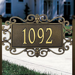 "Frontgate - Mears Fretwork Address Plaque - Crafted from rust-free recycled aluminum. Paints have been specially formulated and weather-tested to withstand even the harshest elements. Designed to provide maximum visibility to meet local ""911"" emergency standards. Please check for accuracy; personalized orders cannot be modified, cancelled, or returned after being placed. Made in the USA. The Mears Fretwork Address Plaque is outlined with an elegantly scrolling pattern.. . . . . For over 60 years, Whitehall has been crafting personalized name and address plaques to provide a distinctive finishing touch to millions of homes. Renowned as the world's largest manufacturer of personalized name and address plaques, Whitehall's reputation for quality and reliability is unsurpassed. Easily assembles with a screwdriver."