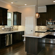 Traditional Kitchen by Gina Hadfield with Champions Real Estate Group