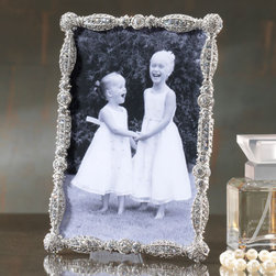 """Exposures - Asbury Frame - Overview Elegant and enchanting, this deco-inspired photo frame adds sparkle to your room. Covered in dazzling Swarovski crystals, its the perfect luxe accent for a side table, shelf or dresser and makes a thoughtful gift. Features White Swarovski crystals Table frame Horizontal or vertical display Comes in a beautiful gift box   Specifications  Measures 4 1/2"""" x 6 1/2"""", holds a 4"""" x 6"""" photo"""