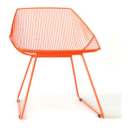Bend Seating - Bunny Lounge Chair, Orange - Maybe you throw your back into the Bunny and crash after a day of catching the California waves. Maybe it cradles you while you dig into a sour, musty copy of The Tokyo-Montana Express. Or maybe you chill in it after hitting the clubs, when you've danced to too much MGMT and are depleted from downing too many Old Fashioneds. Whatever you are recovering from, find yourself in the perfect position to recline. Hot dipped galvanized iron to prevent rust. Slight assembly required.