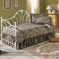 Fashion Bed Group - Emma Daybed Multicolor - RN033 - Shop for Daybeds from Hayneedle.com! The Emma Daybed is timeless graceful and destined to draw attention - or nappers - to any room. This daybed is crafted with a uniquely designed waterfall frame charming curved spindles and an obliquely sloping edge which give the Emma Daybed the same elaborate style so beloved during the Victorian era. The soft antique white frame is designed with a flat lacquer allowing this bed to be maintenance-free and able to complement any decor. Note: Trundle options are not included with the basic set. To include select your choice of package in the configuration field. A trundle is an extra mattress frame stored beneath a daybed which slides out to provide additional sleeping space when needed. The optional trundle packages include your choice of a metal roll-out trundle frame or a metal pop-up trundle frame. The roll-out frame remains low to the ground as an additional twin-sized bed. The pop-up trundle can be left in the lowered position or elevated in the pop-up position to align with the primary daybed mattress. The pop-up feature allows the daybed to transform from a twin-size daybed into a king-size bed. About Fashion Bed GroupFashion Bed Group is a Leggett and Platt Company known for its innovative fashion beds daybeds futons bunk beds bed frames and bedding support. Made in 1991 Fashion Bed Group is a large consolidation of three leading bed manufacturers. Its beds are manufactured of genuine brass plated brass cast zinc cast aluminum steel iron wood wicker and rattan. Fashion Bed Group's products are distributed throughout North America from warehouses located in Chicago Los Angeles Houston Toronto and Ennis Texas.