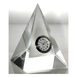 "Godinger Silver - Crystal Pyramid Desk Clock - This modern pyramid clock catches the light to show a dial accented with Roman numerals. This clock makes a charming accent for a bedroom, study or office. It's perfect as a timeless gift to celebrate retirement, new home or other special occasions. Measures approximately 5"" square on the bottom X 7.5"" high."