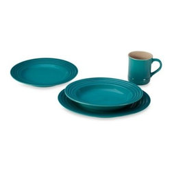 Le Creuset - Le Creuset 4-Piece Dining Set in Caribbean - This 4-pc. dining set is ideal for everyday use with a versatile, sturdy design as well as classic Le Creuset rings around the base. Finished in a vibrant, protective glaze for long-lasting performance.
