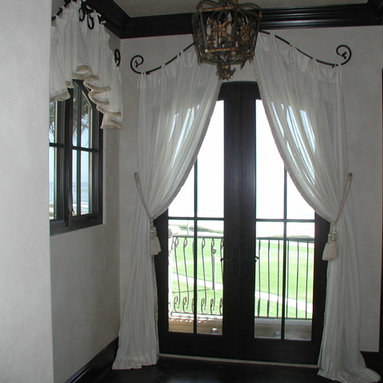 Draperies - Euro pleated sheer draperies with sewn in ties attached to contoured iron rod installed to accent the arched top of the doors.