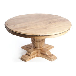 "Vineyard Farm House Trestle Base 60"" Round Dining Table with Leaves - Recycled elm takes center stage in this rustic country table, which features intricate details like a ribbed, threaded base and nail head-edged surface. With two additional leaves, the surface expands to accommodate guests and invites entertaining."
