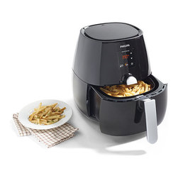 """Frontgate - Phillips Air Fryer - High-power performance for fast cooking results. Fries foods so they???ll be crispy on the outside and tender on the inside. Prepare such diverse foods as grilled fish, homemade pizza, and freshly baked brownies. Integrated air filter keeps your kitchen smelling fresh. Includes a double-layer accessory that maximizes cooking space. Prepare your favorite fried foods with little or no oil. The fryer's rapid air technology circulates hot air as it quickly fries, bakes, roasts, or grills – ensuring perfect texture and delicious results with fewer calories and less mess. The large cooking capacity and manually adjustable time and temperature controls allow infinite cooking options.. Fries foods so they??ll be crispy on the outside and tender on the inside. . . . Includes digital touchscreen controls, automatic shutoff, and smart presets for your favorite setting. Dishwasher-safe parts and nonstick surfaces make for easy cleaning. Includes recipe booklet with more than 30 recipes. Easy cleaning. Two-year manufacturer's warranty. 31"""" cord. UL listed."""