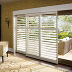 Shutters - Hunter Douglas poly shutters in the family room.