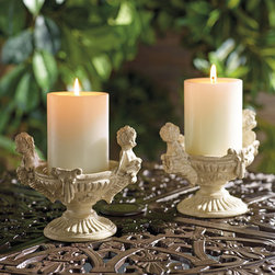 "Frontgate - Set of Two Cherub Candleholders - Frontgate exclusive. Suitable for indoor or outdoor use. Natural stone and resin construction. Candles sold separately. Wipe clean with a soft, damp cloth. These Cherub Candleholders lend heavenly grace as they frame delicate candlelight on your tabletop. Cast in a strong stone composite, each is antiqued with a hand-applied finish and holds a 3"" x 4"" unscented pillar candle (sold separately). . . . . ."