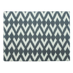basik 855 - basik 855 Highlands Arrow Placemat - basik 855 Highlands Arrow Placemat. Make a stylish statement that you can feel good about! The Highlands Arrow Placemat from basik 855 is the perfect way to add some pattern punch to any tablescape. Woven by hand from fine cotton fabric, it features a graphic-meets-ikat arrow pattern in cool gray and creamy white. Let it create a contemporary layer on your table, or use it to make a bold statement at your next dinner party. Plus, basik 855 donates part of its profits to finding fresh, clean water solutions in Cambodia. Now that's good in more ways than one!Rectangular placemat; back is solid black cottonArtisans receive healthcare, financial planning, and skills training from basik 85510% of profits go to helping with fresh water needsWoven by hand in Cambodia
