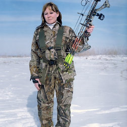 """Lynda, Turkey Hunter, Portage, In"" Artwork - Uniforms, outfits, & accessories we think of the word ""uniform"" to mean the distinctive clothing worn by members of the same organization. however, in today's society the term is somewhat distilled and can be used interchangeably to denote outfits that are similar in nature, but not exactly the same, and not necessarily worn by members of an organization. the history of the uniform, goes back to the history of clothing and textiles. textiles are defined as felt or spun fibers made into yarn that are netted, looped and knitted or woven into fabrics. they first appeared in the middle east during the late stone age. from these ancient times to the present day, the production of textiles evolved and influenced how people clothed themselves.  uniforms, and outfits, are a decisive part of the human physical appearance and this appearance has a social significance in all parts of the world. every society has a dress code that is well defined and understood by most members of that particular group. the dress code has specific rules, which in turn signal a message given by a person's clothing and the way it is worn. the message may indicate income, social class, religious affiliation, attitude, sexual orientation, marital status, or sexual availability. it may be seen in the clothes worn in the armed services, the paramilitary, the police, security guards, and the clergy. it can also be seen in shops, banks, post offices airports, bars, restaurants and hotels, sports teams, clubs, schools, and prisons. sometimes corporations use uniforms to create a brand or corporate image. (the first service uniform registered in the u.s. patent and trademark office was the playboy bunny outfit.). uniforms, and outfits in general, send social signals that usually indicate personal and cultural identity.  the idea of dress code works on many levels and is defined in many ways. one examp..."