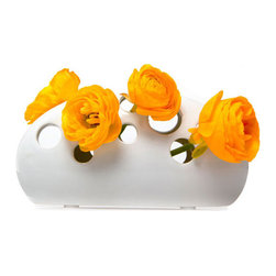 Holey Bud Vase - Garden clippings and springtime findings look great peeking out from the multitude of holes on this playful bud vase. Made from white ceramic, it's a fun and modern way to display your flowers.