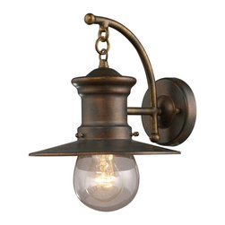 Elk - 1 Light Wall Bracket in Hazlenut Bronze and Clear Seeded Glass - This Maritime Collection 1 Light Wall Sconce features an aged bronze finish with contrasting white glass. This outdoor sconce is perfect for any patio or porch light, and offers a classical style reminiscent of maritime fashion. Brighten your cool spring nights with this fashionable outdoor sconce.