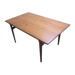 Pre-owned Danish Dining Table Johs Andersen Style - If you are looking for the best vintage Danish Mid-Century dining table money can buy, you have found it!  The teak is flawless, the operation of the pull out leafs is butter smooth. It has beautiful grain figure and color- a masterfully executed modern classic made in Denmark in the 1960s. The table is very much in line with Johannes Andersen's style, but we cannot ascertain with full certainty that it is indeed by Johs Andersen.