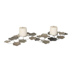 Uttermost Lying Lotus Metal Candleholders - Champagne silver and pewter. White candles included. Candleholder is made of hand forged metal finished in champagne silver and pewter. This may be hung on wall or used on tabletop. Two white candles included.